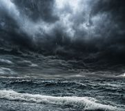 Storm over ocean. Dark stormy sky over ocean with big waves Stock Images