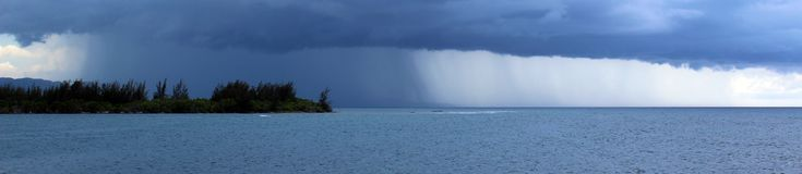 Storm over the ocean in Jamaica, tropical paradise with rain over the beach from the sea.