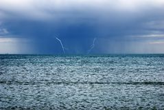 Storm over the ocean. Storm with lightnings over the ocean Stock Images