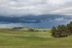 Storm Over the Prairie. The dynamic landscape of Wind Cave National Park hills and prairie with an ominous looking storm above royalty free stock photography