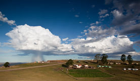 Storm over rural village Royalty Free Stock Images
