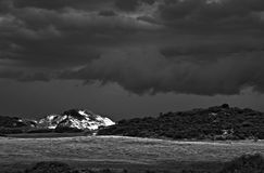 Storm over sand dunes. A high contrast picture of a storm breaking over some coastal sand dunes Royalty Free Stock Images