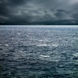 Storm over sea. Seascape image of windy weather and waves on sea over cloudy sky Stock Image