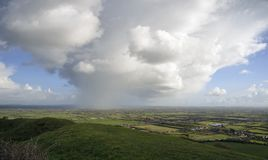 Storm over Somerset Levels. Storm Clouds with Heavy Rain over Somerset Levels Viewed from top of Brent Knoll Royalty Free Stock Photo