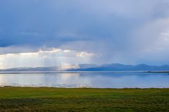 Storm over Song Kul lake. Storm cloud over Song Kul lake, Kyrgyzstan Stock Photos