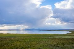 Storm over Song Kul lake. Storm cloud over Song Kul lake, Kyrgyzstan Royalty Free Stock Photos