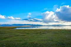 Storm over Song Kul lake. Storm cloud over Song Kul lake, Kyrgyzstan Royalty Free Stock Image