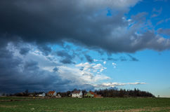 Storm over the village Royalty Free Stock Image
