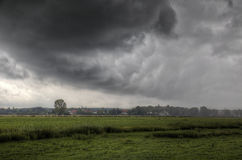 Storm over a village Stock Photography