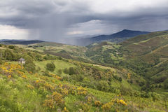 Storm passing by the mountains near O Cebreiro Stock Photo
