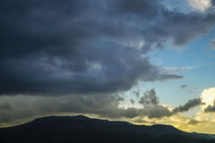 Storm and rain cloud moving past the mountain Royalty Free Stock Photos