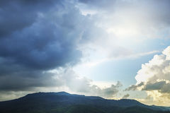 Storm and rain cloud moving past the mountain Royalty Free Stock Photography
