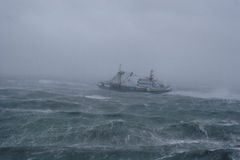 Storm,rain and a fishing boat. Stock Photo