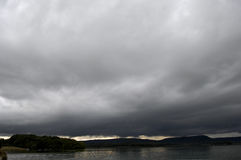 Storm and Rain over lake, France Royalty Free Stock Photos