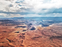 Storm and rain over red canyon with river Stock Images