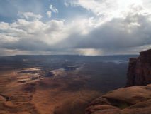 Storm and rain over red canyon with river Stock Photo