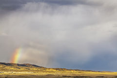 Storm and rainbow over prairie Stock Photo
