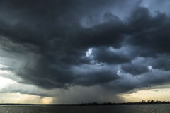 Storm and raincloud over lake in Sri Lanka Stock Image