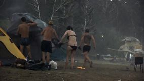 Storm rips tents off People try to keep their tents, but a hurricane soon tear them and carry away. stock video footage