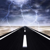 Storm on the road. Road with a thunder storm over it Royalty Free Stock Images