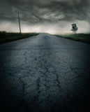 Storm on the road. Storm clouds rolling in over a old road in the country Stock Photos