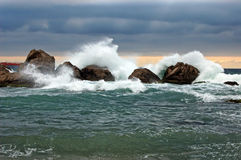 Storm beside the rock Royalty Free Stock Photo