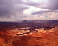 Storm's-A-Comin'. A leaden summer's storm moves across the desolate wastes of southern Utah and the upper canyons of the Colorado River, leading to the contrast Royalty Free Stock Images