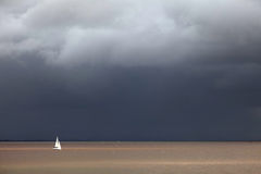 Storm and sailboat Stock Photo