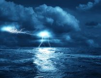 Storm on sea. The storm on sea from lightnings on background of clouds Stock Photos