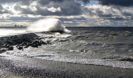 Storm by the sea in Tallinn, Estonia. Storm by the sea. Water waves beat the mole and bounce up in the sky after which the wind carries them over the mole Stock Photo