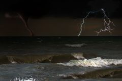 Storm on sea. Big wave and lighting with hurricane on thuderstorm sky.  stock photography
