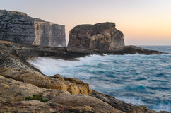 Storm on the sea, Dwejra, Gozo Island. Cliffs of Gozo Island with small islet Fungus Rock during the spring storm. Dwejra, Maltese archipelago Stock Image