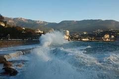 Storm at the sea and embankment street of Yalta city in Crimea in the morning on 24.10.2016. Big waves and tides wash Stock Image