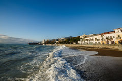 Storm at the sea and embankment street of Yalta city in Crimea in the morning on 24.10.2016. Big waves and tides wash Royalty Free Stock Photography