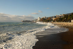 Storm at the sea and embankment street of Yalta city in Crimea in the morning on 24.10.2016. Big waves and tides wash Royalty Free Stock Images