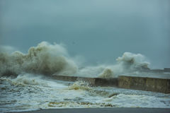 A storm at sea, hurricane and concrete piers Stock Images