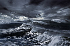 Storm at sea. Storm in ocean with big windy waves; Northeast Atlantic Coast; enhanced sky; toned blue Royalty Free Stock Image