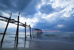 Storm at sea with old bridge. Storm seascape with abandon wooden bridge in Phang Nga beach in Thailand Royalty Free Stock Photo