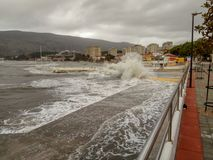 Storm in the sea, pier by the sea royalty free stock photo