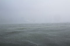 Storm on the sea with rain downpour Royalty Free Stock Photography