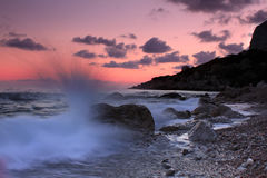 Storm at sea shore. Stormy sunset at tropical sea Royalty Free Stock Photos