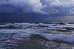 Storm in the sea at sunset. Beautiful seascape Stock Images