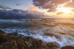 Storm in the sea at sunset. Beautiful seascape Stock Photos