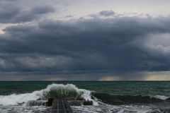 Storm. At sea. Wave above the harbor Stock Image