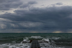 Storm on the sea. Storm at sea. Wave above the harbor Royalty Free Stock Photo