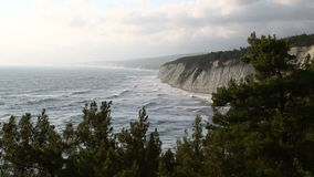 Storm sea waves beat on the rocky shore. The top view. stock footage