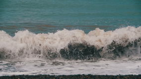 Storm on the Sea. The Waves are Rolling on a Pebble Stone Beach. Slow Motion. In 96 fps. Sea Surf on the beach. Big waves on an exotic beach. Stormy seas during stock footage