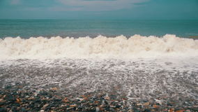 Storm on the Sea. The Waves are Rolling on a Pebble Stone Beach. Slow Motion. In 96 fps. Sea Surf on the beach. Big waves on an exotic beach. Stormy seas during stock video footage