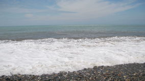 Storm on the Sea. The Waves are Rolling on a Pebble Stone Beach. stock footage