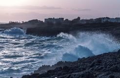 Storm seascape at dusk. sunset sea over cliff and rocks. Taranto Royalty Free Stock Photography